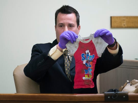 Det. Bill Rumell holds up the shirt 3-year-old Brendan Creato was wearing when his body was found during day six of testimony Wednesday, May 3, 2017 in Camden.
