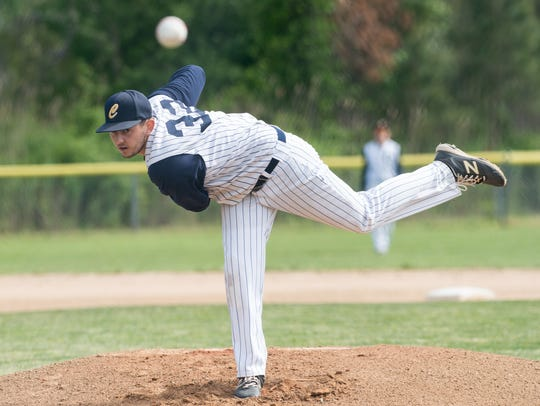 Chincoteague pitcher Trey Fisher (32) throws a pitch
