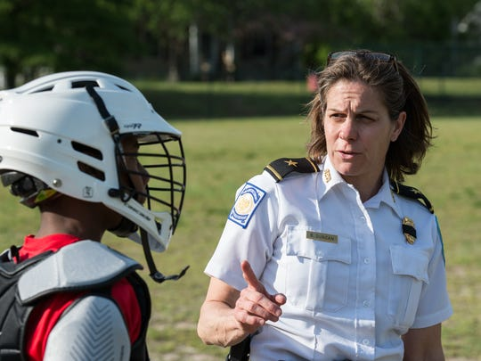 Salisbury Police Chief Barbara Duncan talks to a player about lacrosse technique.
