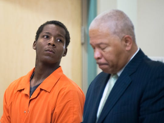 Murder suspect Shaquan Brown, left, appears in court