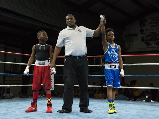 Marcelo Steele, right, is named the winner during the Junior Olympic Regional Tournament at Main Street Gym on Friday, May 19, 2017.