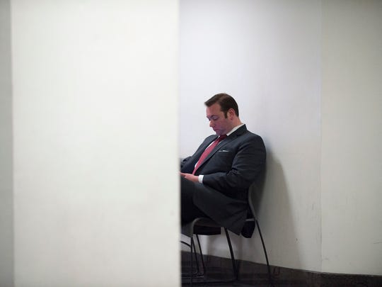 Defense attorney Richard Fuschino Jr. waits in the hallway during day two of jury deliberation Thursday, May 25, 2017 in Camden.