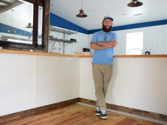 "Burley Oak Brewing Company founder Bryan Brushmiller stand in the new location ""The Brewers Cafe"" located on Jefferson Street in downtown Berlin. Wednesday, May 31, 2017."