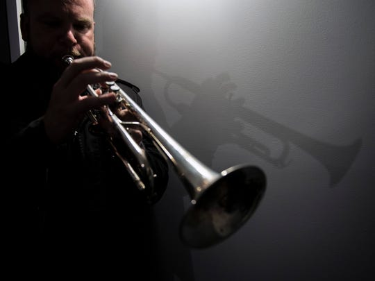 Matt Cappy of Collingswood plays his trumpet inside his rehearsal space at Gradwell House Recording in Haddon Heights.