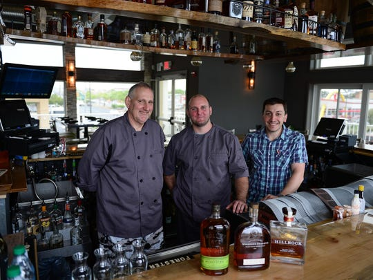Joel Blice, Chef Stuart Diepold and Owner Sal Fasano stand behind the bar at the new Rare & Rye Restaurant located on 32nd St in the La Quinta Inn & Sweets on Tuesday, June 6, 2017.