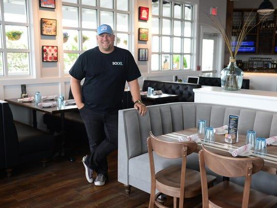 Scott Kammerer stands inside the massive Bluecoast restaurant on Coastal Highway last June.