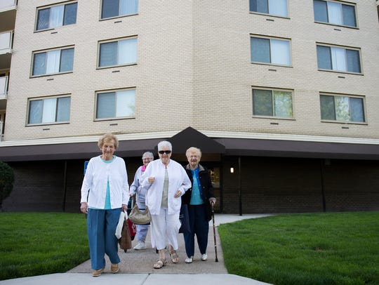 Ida Geltzer, 92, right (with cane), walks with friends