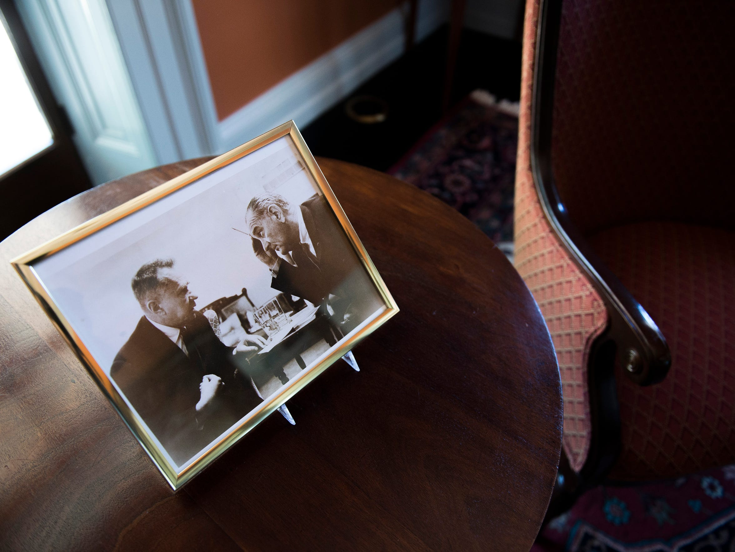 A photograph is displayed on the table between the