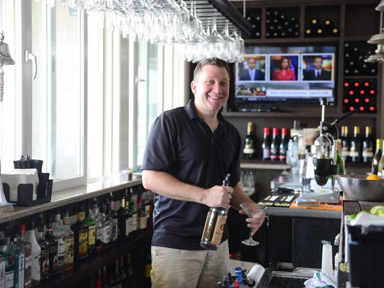 Gilligan's Bartender Andrew Drawdy at the newly remodeled