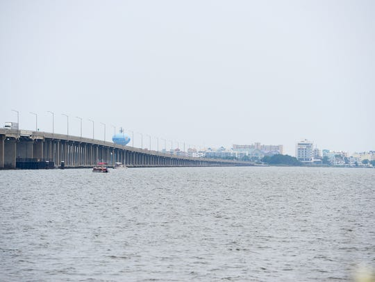 Two unidentified men leapt into the bay Wednesday from