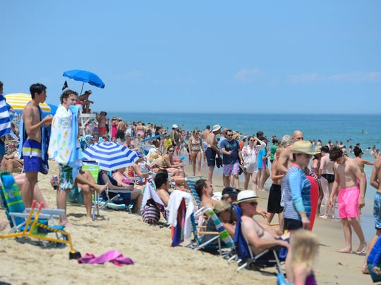 The beaches in Bethany Beach, DE. are full of swimmers and vacationers during the holiday week on July 3, 2017.