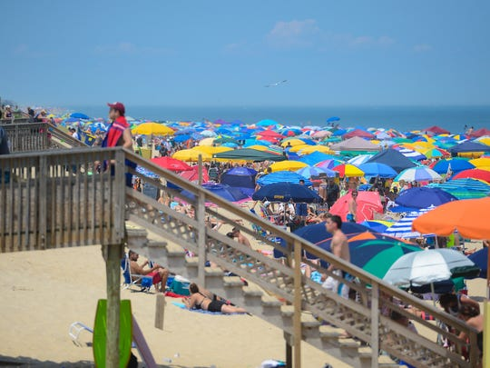 A large crowd fills the Bethany Beaches during a holiday week on July 3, 2017.