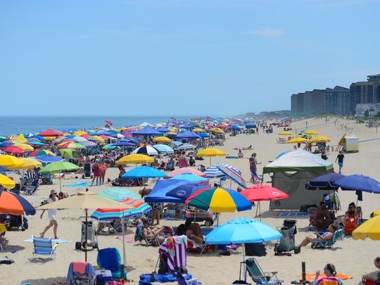 Umbrella's can be seen for miles at the Bethany Beaches during this holiday week on July 3, 2017.