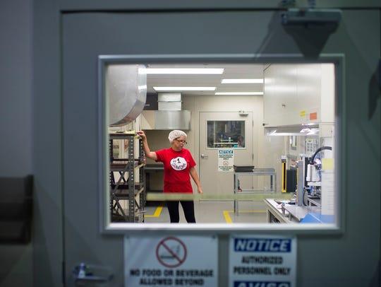Stephanie Ott manufactures micro tubes inside Richland