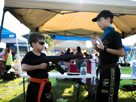 Nathan Dziewonski, 8, left, and his brother Christian