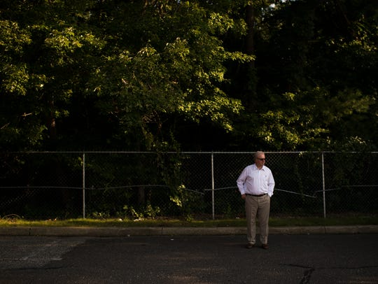 Gibbsboro Mayor Ed Campbell stands by a fenced off