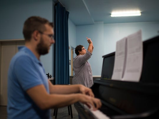 Maestra Liz Braden, right, conducts as principal pianist Resse Revak plays during a rehearsal for 'The Wake World' with Opera Philadelphia.