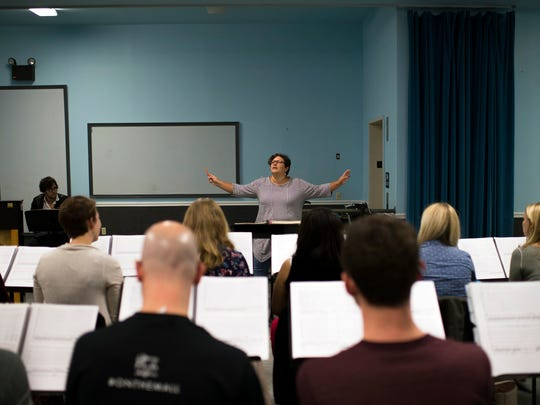 Maestra Liz Braden conducts during a rehearsal for 'The Wake World' with the Opera Philadelphia. She is a rare figure in the opera world, a woman conductor..
