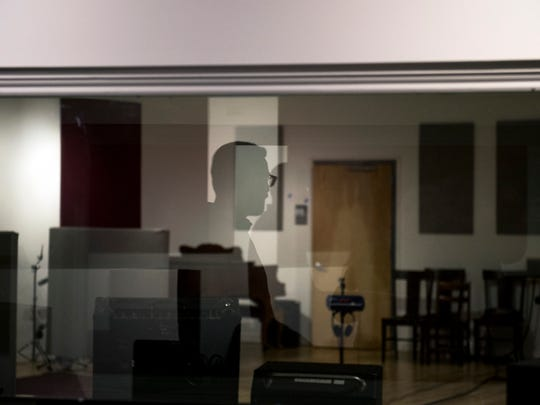 Gradwell House Recording co-founder Steve Poponi is reflected in a control room window overlooking the new studio Tuesday, Oct. 3, 2017 at Gradwell's new location in Haddon Heights.
