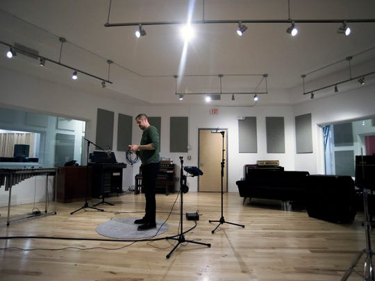 Gradwell House co-founder Dave Downham gathers a microphone cable inside the new studio space Tuesday, Oct. 3, 2017 in Haddon Heights.