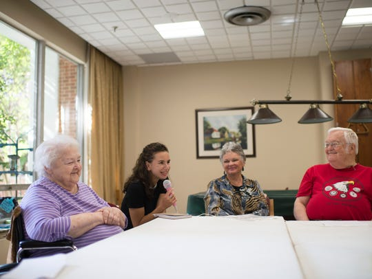 Joanna Flynn, 17, shares a poem with residents during