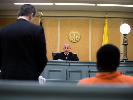 Judge Michael J. Silvanio listens as Attorney Richard
