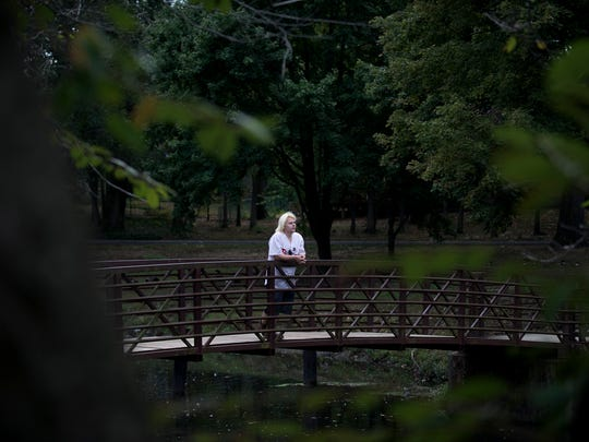 Matt Di Serio, 27, poses for a portrait at his favorite park, near his home in Cherry Hill. Di Serio is in long-term methadone treatment for an addiction to opioids.