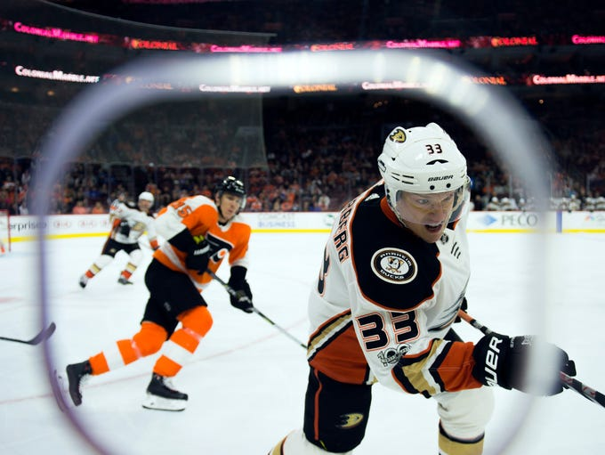 Anaheim Ducks' Jakob Silferberg (33) chases the puck