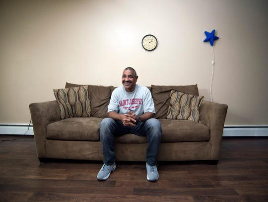 Miguel Rodriguez shares his story inside his Magnolia apartment. The 55-year-old was the 11th person to enter the Housing First program launched Camden Coalition of Healthcare Providers.