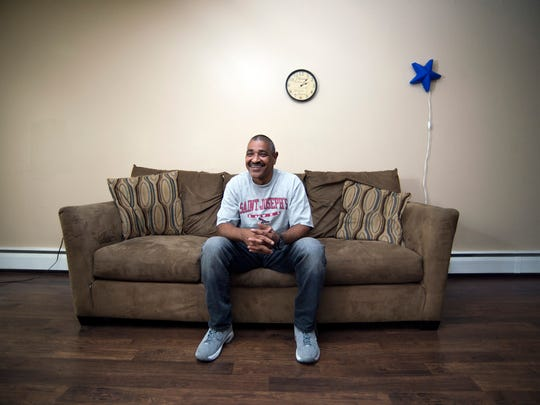 Miguel Rodriguez poses inside his apartment Friday, Nov.3, 2017 in Magnolia. Rodriguez, who's been living there since March 2016, was the 11th person to enter the Camden Coalition's Housing First program.