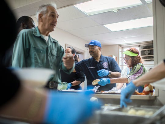 Bridgeton Mayor Albert Kelly helps serve community members during a Thanksgiving lunch Wednesday, Nov. 22, 2017 at Society of St. Vincent de Paul in Bridgeton.