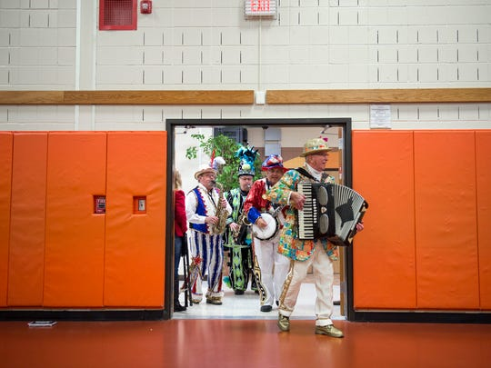Mummers Dan Sickels, from left, Robert Griffiths Sr., Bob Stango and Dan Eberhardt enter the Burlington County Special Services School gym as they perform for students Friday, Dec. 1, 2017 in Westampton, New Jersey.