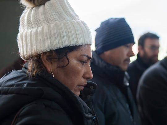 Humberta Campos prays alongside her husband Oscar Campos Wednesday, Dec. 6, 2017 outside Sen. Cory Booker's office building in Camden, New Jersey. Oscar and Humberta Campos are facing deportation back to Mexico, and have three children that would be left behind.