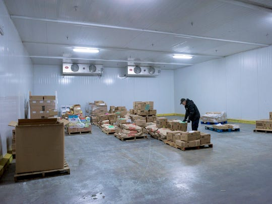 Inside the cold storage area at the Food Bank of South