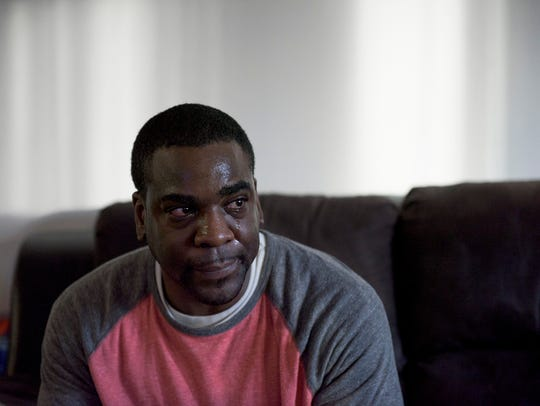 Darnell Huff, 37, of Cherry Hill becomes emotional while discussing his family's finances. The Army veteran works as an auto technician, but has struggled to pay rent. Employees at Avista Healthcare, a long-term care and rehab facility on Chapel Ave., donated gifts and a Christmas tree for the family's four children.