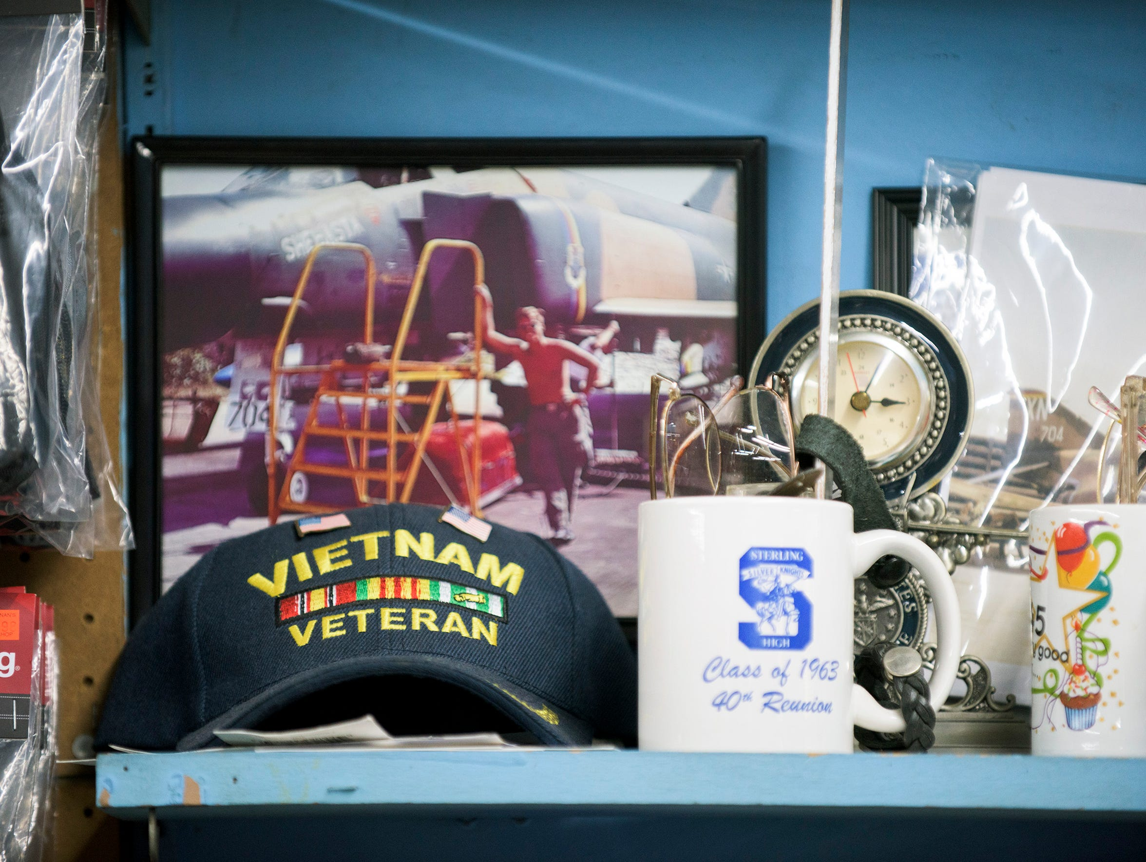 Joe DiPietro's Vietnam Veteran cap lays on a shelf inside his shop at the Berlin Farmers Market.