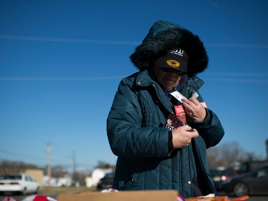 Barb Hitman picks up groceries from the Food Bank of