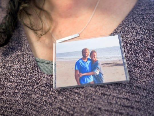 Lynn Carpenter wears an image of her friend Colleen