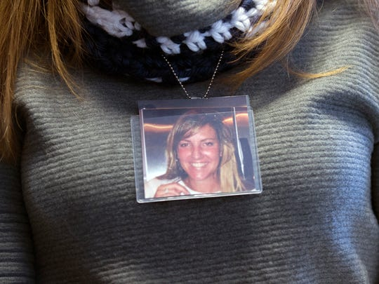 Maria Kirk wears an image of her friend Colleen Brownell,