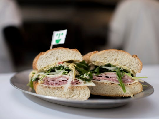 A So Long Sal! sandwich with salami, prosciutto cotto, onion, sharp provolone, house dressing, artichoke spread and arugula on a Sarcone's hoagie roll at Middle Child in Philadelphia.