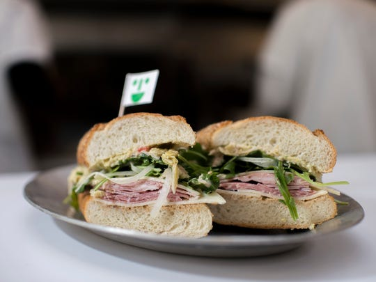 A So Long Sal! sandwich with salami, prosciutto cotto, onion, sharp provolone, house dressing, artichoke spread and arugula on a Sarcone's hoagie roll Wednesday, Jan. 10, 2018 at Middle Child in Philadelphia.