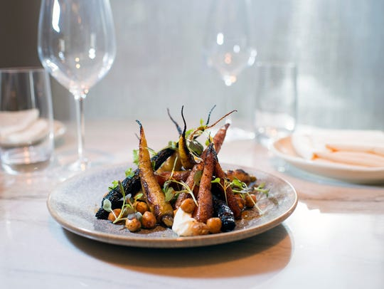 """Wood-roasted Carrots make the most of Hearthside's hearth, which adds """"a layer of smoky richness to locally sourced carrots, playing against creamy, faintly tangy house- made ricotta. Crispy, roasted chickpeasspiced with herbaceous za'atar add texture to the plate."""