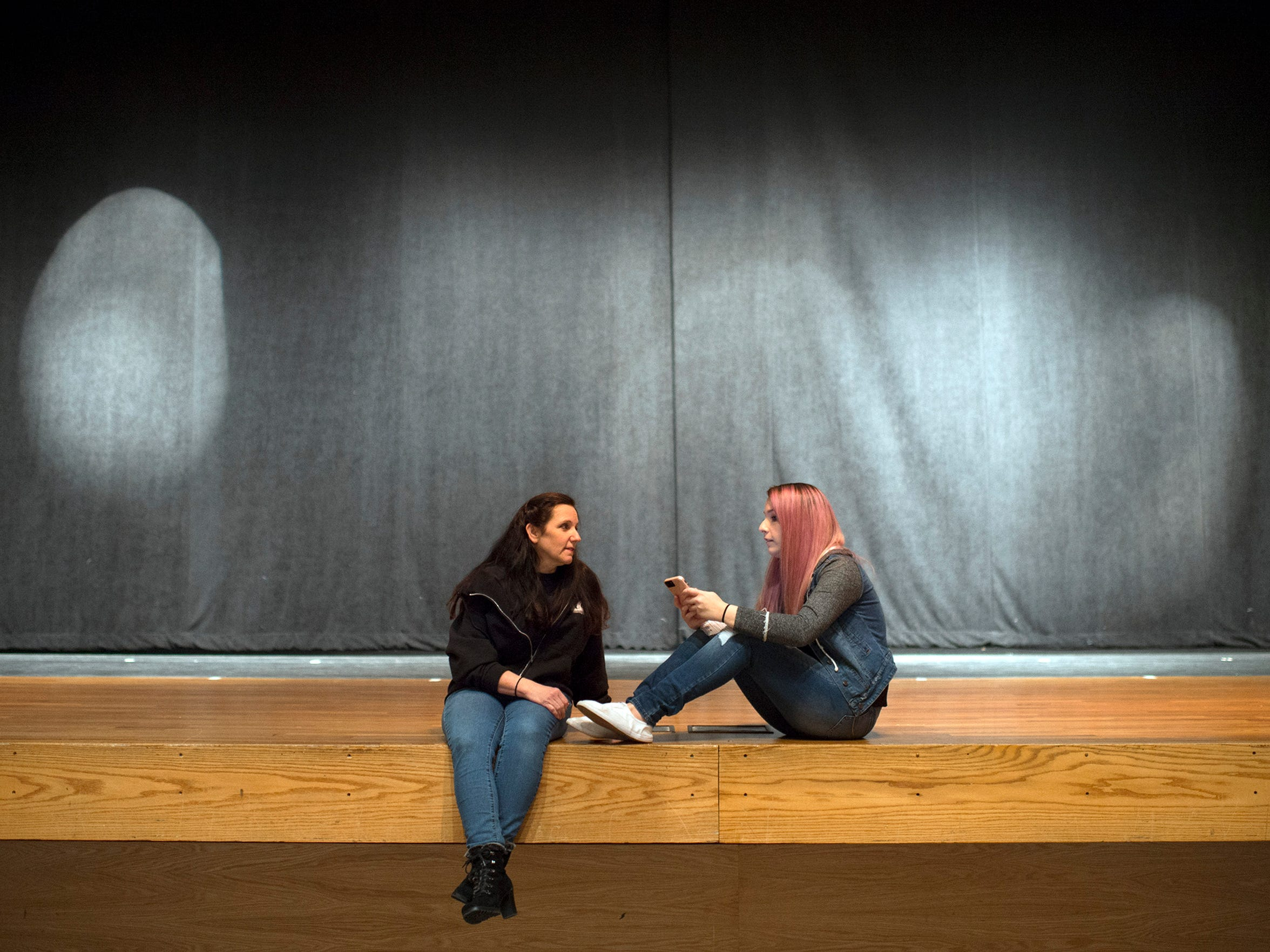 Charlene Maycott, left, sits on stage with her daughter Monica Maycott as they pose for a portrait before an addiction awareness event Thursday, Jan. 25, 2018 at Williamstown High School in Williamstown, N.J. Monica is in recovery for heroin addiction.