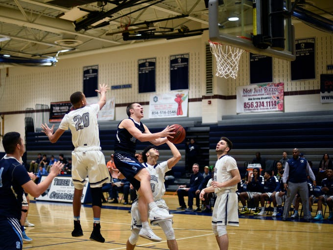 Shawnee's Dean Noll (31) drives to the basket against