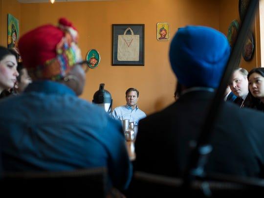 Congressman Donald Norcross listens as young professionals