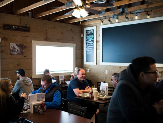 Customers fill the dining room at Outlaw's Burger Barn