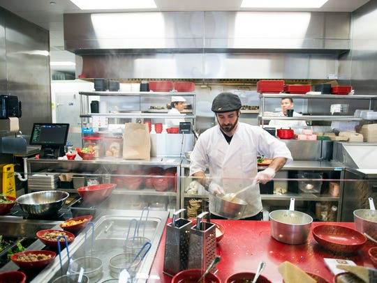 Marino's Kitchen franchisee Mike Maglione perpares a dish at the Marlton fast casual restaurant.