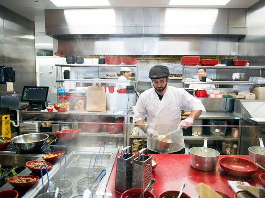 Store owner Mike Maglione prepares a dish inside Marino's Kitchen Wednesday, March 14, 2018 in Voorhees, N.J.