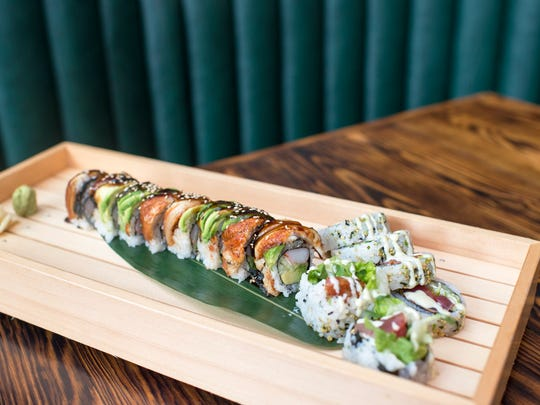 A dragon roll, left, and peppered tuna roll from Tuna