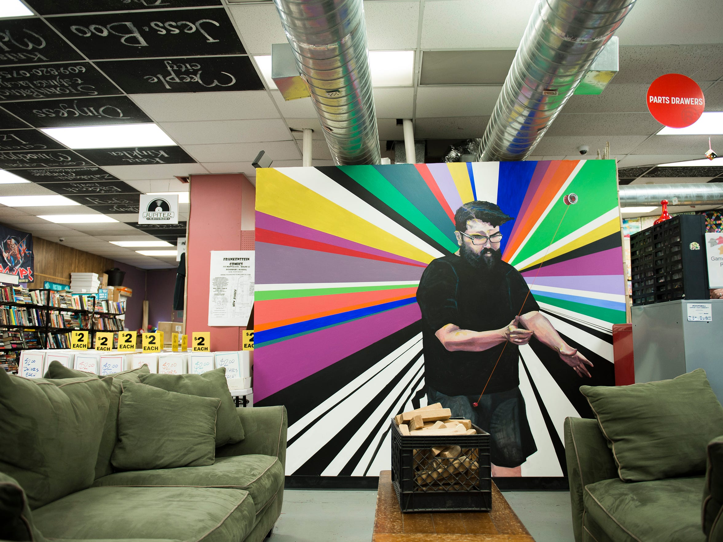 A painting of A.J. Kirk on display inside Tiki Tiki Board Games Tuesday, March 27, 2018 in Woodbury, N.J. Kirk, who passed away in 2015, started the yo-yo club in 2014.